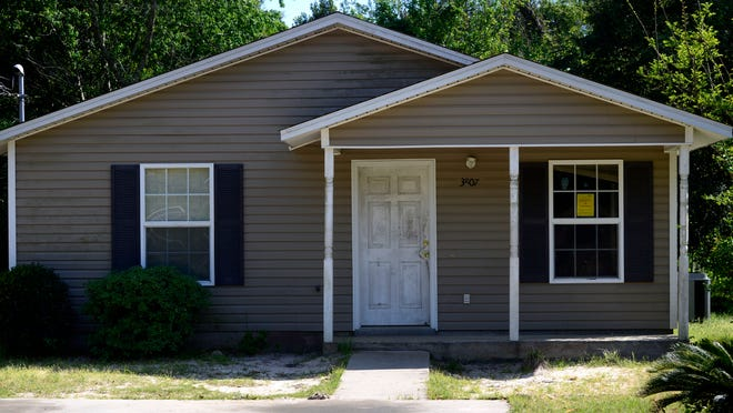"Cash problems have prompted Pensacola Habitat for Humanity to sell 20 foreclosed houses and vacant lots, like this one located on Moreno Street, in a ""bundle"" to a for-profit buyer."