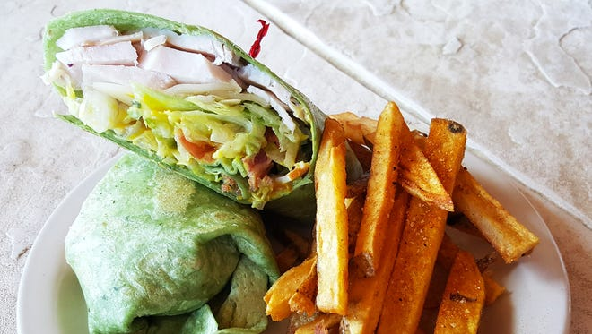 The Aggie Wrap ($7) from The Player's Grill has turkey, Swiss cheese, lettuce, tomato, bacon and honey mustard in a grilled spinach wrap with a side of fries.