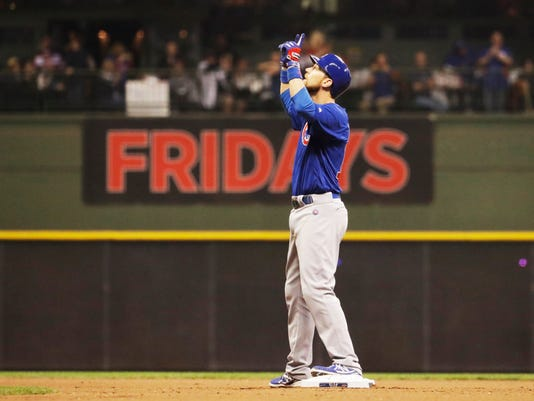 Chicago Cubs' Ben Zobrist celebrates after hitting a double off Milwaukee Brewers starting pitcher Chase Anderson during the eighth inning of a baseball game Tuesday, May 17, 2016, in Milwaukee. (AP Photo/Morry Gash)