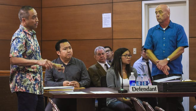 Defendants Orlando Domingo, seated left, and Ana Kristine Absalon, appear with their lawyers before Judge Alberto Lamorena III at the Superior Court of Guam in Hagåtña on Tuesday, Jan. 17, 2017. Both were indicted in connection with Prestige Automobiles' alleged luxury car scam.
