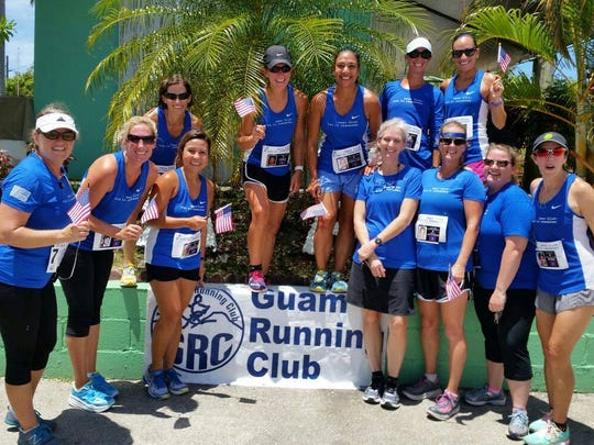 The Perimeter Relay team from the Guam Running Club are all smiles following their grueling sprint around Guam.
