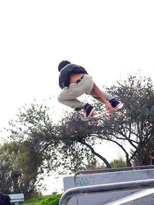 Victor Lopez, 16, practices his skateboard tricks at Natividad Creek Park.