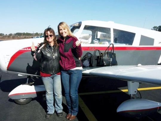 Eva Gardner, 51, of Fredericksburg, Va., and Stephanie Wrenn, 32, of Raleigh, N.C., stand in front of the plane they'll be flying next week during the 39th annual Air Race Classic, an all-women's flying competition. Gardner said she grew up less than 10 miles from the York Airport, but never new anyone who flew. In 2011, after almost one year, she earned her private pilot license.