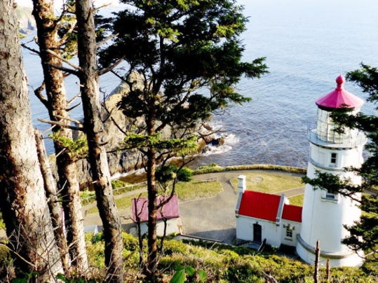 Hiking trails offer peekaboo views from above the Heceta Head Lighthouse.