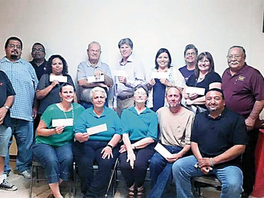 Submitted Photo   Standing, from left, are: Moose members Kevin Parham, Gilbert Torres and Jerry Rivera; Veronica Olvera, Little League; Don Hill, Cancer Support; Eric Olson, Down Syndrome Families; Irene Trejo and Kathleen Sayre, Healing House; Barbara Rios, Senior Center; and Moose Gov. Manuel Garcia. Seated, from left, are: Janean Garney Animal Shelter; Adele Moreno and Maureen Hill, Special Olympics; John Scot-Wrigh,t Helping Hand and George Cobos, Jr. Gov.