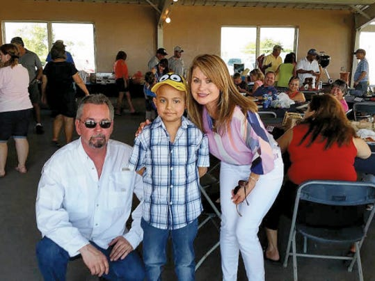 Eder Soto, 8, a guest at the Ronald McDonald House in El Paso undergoing treatment for leukemia, poses with with Las Cruces McDonald's owner Mike Lavin and Maria Meyer at the Southwest Airlines/Ronald McDonald House Charities Fundraising Golf Tournament & Auction in Las Cruces in July.