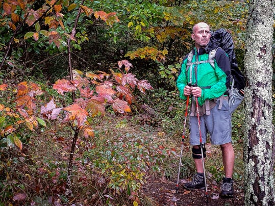 Hiking partner Scott Holloway of Anderson, SC, looks out over the Pinnacle, the high point of the Foothills Trail in South Carolina. John A. Pavoncello - jpavoncello@yorkdispatch.com