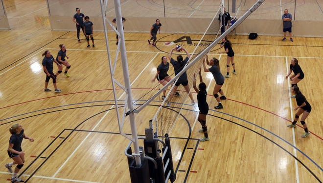 Alliance Volleyball players scrimmage during the farewell event for A-Game in Franklin Thursday March 31, 2016.