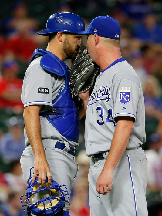 Kansas City Royals catcher Drew Butera (9) visits relief pitcher Travis Wood (34) on the mound in the 13th inning of a baseball game against the Texas Rangers in Arlington, Texas, Thursday, April 20, 2017. (AP Photo/Tony Gutierrez)