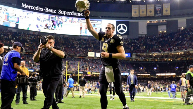 New Orleans Saints quarterback Drew Brees (9) celebrates after a win against the Seattle Seahawks in a game at the Mercedes-Benz Superdome. The Saints defeated the Seahawks 25-20.