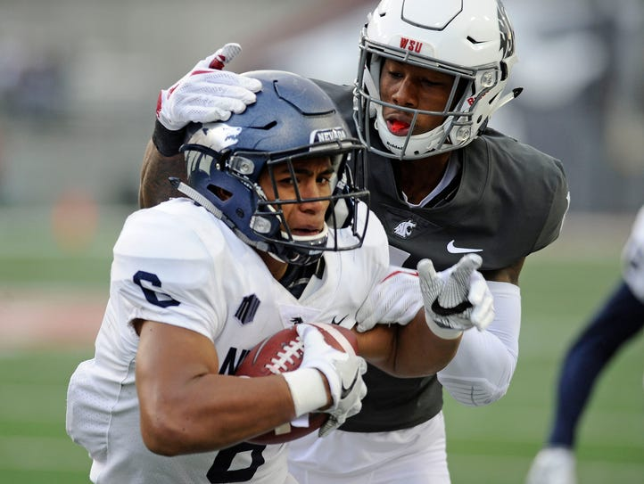 Wolf Pack defensive back Nephi Sewell jumps the route