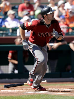 Arizona Diamondbacks' A.J. Pollock watches his solo home run during the first inning of the team's spring training baseball game against the San Francisco Giants, Sunday, March 12, 2017, in Scottsdale, Ariz.