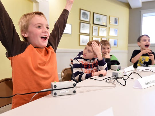 William McKinney of Timbo Schools cheers a correct answer during Bug Bowl on Friday during the 14th Annual Insectival at ASUMH. Also shown are teammates, from left, Mason Gatewood, Paul Hacker and Tyler Patrick.