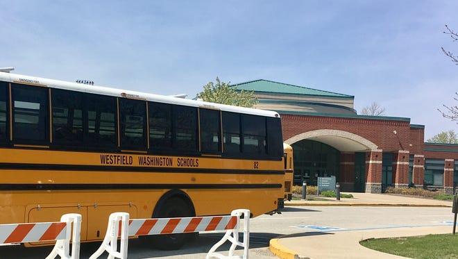 A bus parks outside Westfield High School.