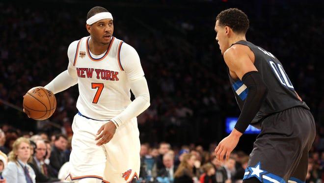 New York Knicks small forward Carmelo Anthony looks to make a move around Orlando Magic power forward Aaron Gordon during the third quarter at Madison Square Garden Thursday night.