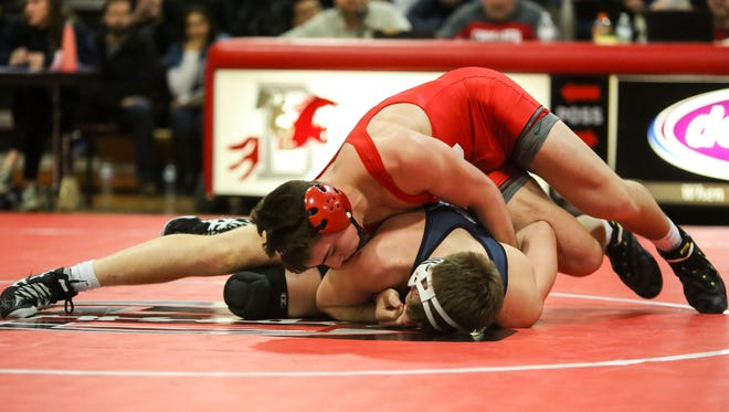 Delsea's Billy Janzer, top, controls Gateways Matt Goetz at 170 pounds on Friday night. The Crusaders beat Gateway 49-23 to win the South Jersey Group 3 title.