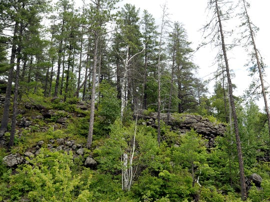 Mining operations exist throughout the Upper Peninsula interspersed among picturesque scenery, such as this fenced off area near the Eagle Mine nickel/copper mine in Michigamme Township, near Marquette, in Michigan's Upper Peninsula.