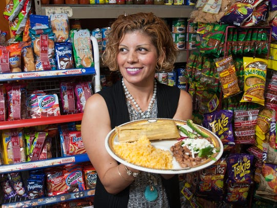 Tortilleria La Rancherita owner Yesenia Judice holds a plate with a tamale made in her restaurant in Bonita Springs.