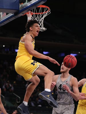 Nov 17, 2016; New York, NY, USA; Michigan Wolverines forward D.J. Wilson dunks in the second half against Marquette at Madison Square Garden.
