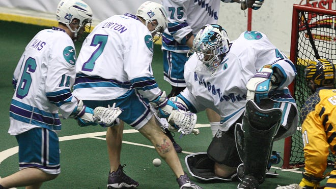 Knighthawks goalie Matt Vinc, right, watches the ball after blocking it in the first quarter of an 8-6 win over visiting Minnesota Saturday.