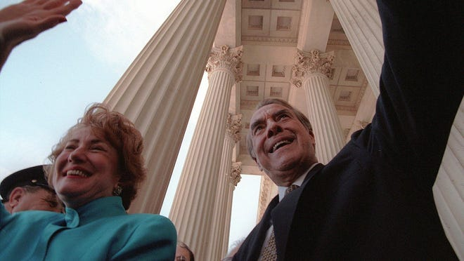 Bob Dole leaves the U. S. Capitol on June 11, 1996, with his wife, Elizabeth, after the Republican from Kansas ended 35 years in the Senate to run for president.