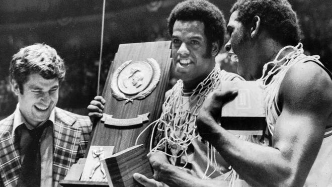 Indiana coach Bobby Knight, left, and team members Scott May, center, and Quinn Buckner from the last team that went undefeated and won the NCAA Tournament in 1976.