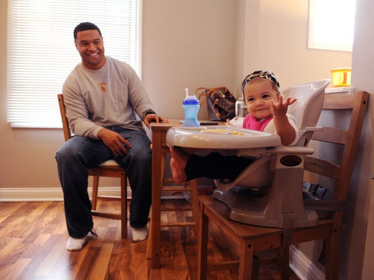 Indianapolis Colts fullback Stanley Havili and his family, his wife Jocelyn and 1-year-old daughter Holiday, in this home in Carmel.