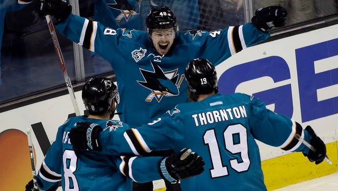 San Jose Sharks' Tomas Hertl (48) celebrates his goal with teammates Joe Thornton (19) and Joe Pavelski (8) during the third period in Game 3 Thursday of the Western Conference finals against the St. Louis Blues in San Jose, Calif. San Jose won 3-0 to take a 2-1 lead in the best-of-seven series.