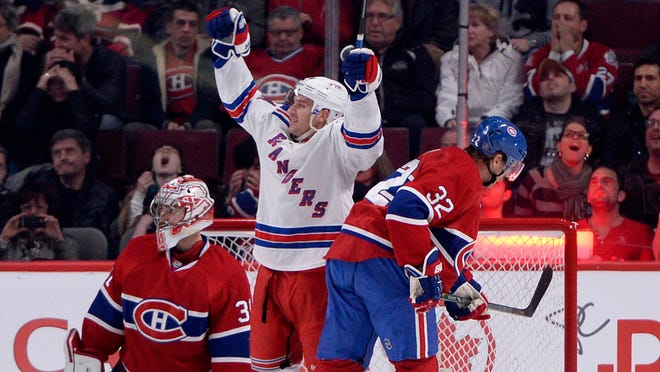 New York Rangers forward Ryan Callahan (24) celebrates after scoring a goal against Montreal Canadiens goalie Carey Price (31) during the second period at the Bell Centre.