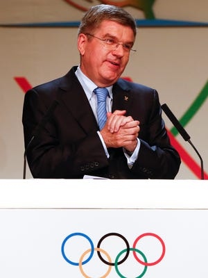 Thomas Bach, of Germany, acknowledges the crowd giving him a standing ovation after he was named as the new president of the International Olympic Committee (IOC) at the 125th IOC session in Buenos Aires, Argentina, Tuesday.