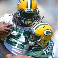 Green Bay Packers linebacker Josh Francis, right, wraps up running back Eddie Lacy during organized team activities practice at Clarke Hinkle Field on Thursday, May 28, 2015.
