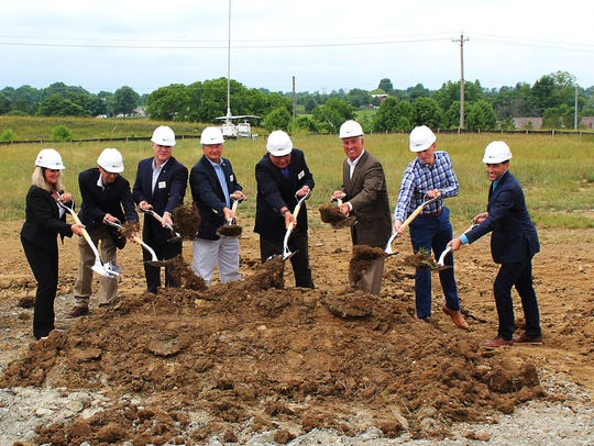 Officials from senior living community builder StoryPoint,