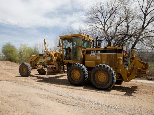 Construction work on a sewer line continues Thursday near the Aztec Municipal School District offices.