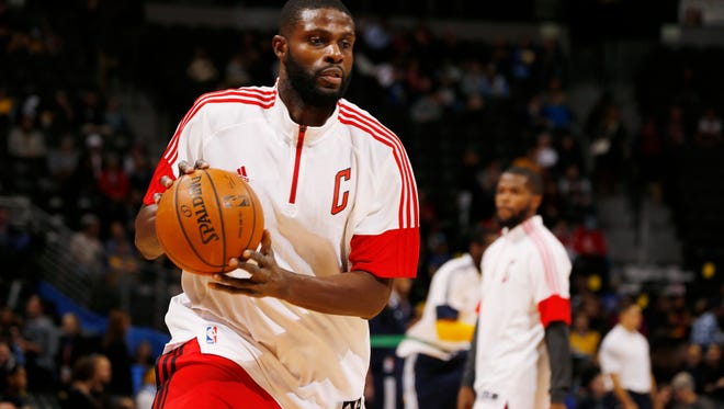 Chicago Bulls center Nazr Mohammed warms up before facing the Denver Nuggets in the first quarter of an NBA basketball game in Denver on Tuesday, Nov. 25, 2014. (AP Photo/David Zalubowski)