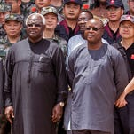 In this photo taken on Sept. 25, 2014, Chinese Ambassador Zhao Yanbo, center left, stands next to Sierra Leone's President Ernest Bai Koroma, center, and  Sierra Leone's Vice President Samuel Sam-Sumana,  centre right, during the opening ceremony of  the China Friendship Hospital catering for Ebola virus patience in Freetown, Sierra Leone. Sierra Leone's vice president has put himself in quarantine following the death from Ebola of one of his security guards. Sam-Sumana voluntarily decided to quarantine himself for 21 days following the death from Ebola last Tuesday Feb. 24, 2015,  of one of his security personnel, according to a report issued late Saturday,  Feb. 28, 2015, by the Sierra Leone Broadcasting Corporation.