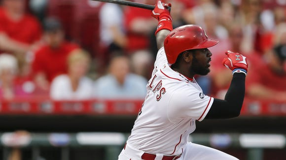 Cincinnati Reds second baseman Brandon Phillips (4) singles in the second inning during the MLB game between the Colorado Rockies and the Cincinnati Reds, Tuesday, April 19, 2016, at Great American Ball Park in Cincinnati.