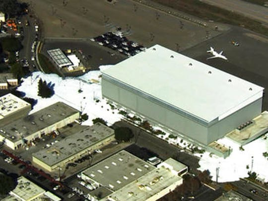 In this image provided courtesy of KTVU-TV, foam spills out of a hanger building at the Mineta San Jose International Airport, Friday, Nov. 18, 2016, in San Jose, Calif. The San Jose fire department said a malfunction of the new hangar's fire prevention system caused the flooding foam.