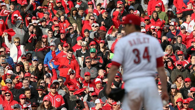 Fans cheer on Cincinnati Reds starting pitcher Homer Bailey (34) in the sixth inning during the Opening Day National League baseball game between the Washington Nationals and the Cincinnati Reds, Friday, March 30, 2018, at Great American Ball Park in Cincinnati.