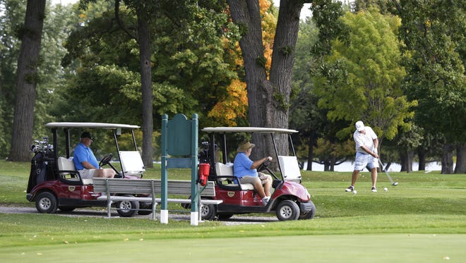 A golfer tees off Friday, Sept. 15, 2017, at Lakeshore Municipal Golf Course in Oshkosh.