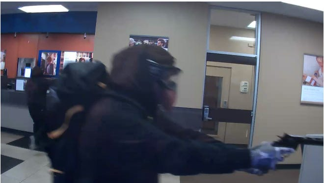 The men robbed a bank wearing what appears to be gas masks Wednesday morning.