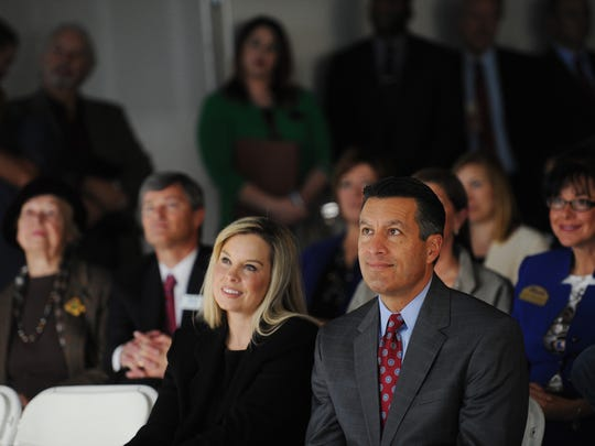 Reno Mayor Hillary Schieve sits with Nevada Governor Brian Sandoval during an EDAWN press conference announcing Clear Capital's move from Truckee to Reno at Park Center Tower on Jan. 6, 2015.