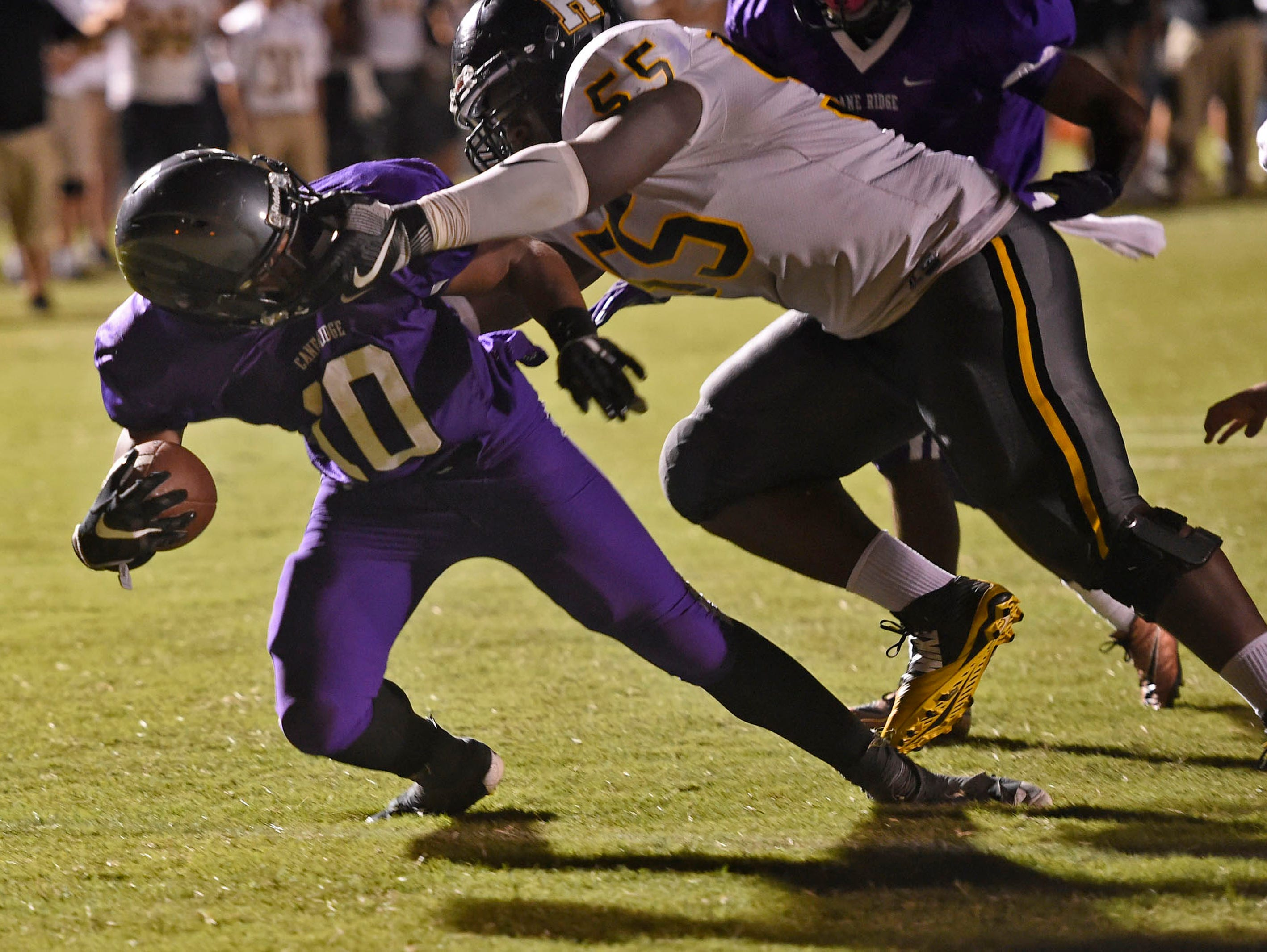 Hendersonville's Derek Grandberry, 55, tries to stop Cane Ridge RB Jordan Bell, 10. Even a face mask couldn't keep Bell from scoring the touchdown that tied the game on Friday, September 2, 2016. Cane Ridge won 47-46.