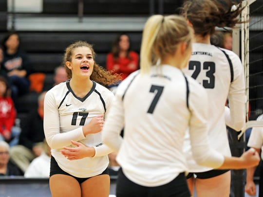 Ankeny Centennial junior Ari Winters (17) celebrates with her teammates as the Sioux City East Black Raiders battles against the Ankeny Centennial Jaguars during the Class 5A regional final volleyball match at Ankeny Centennial High School on Monday, Oct. 30, 2017.