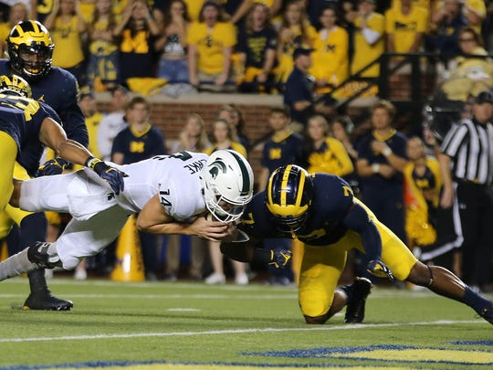 Brian Lewerke dives into the end zone for a score against Michigan during the Spartans' 14-10 win in October of 2017.