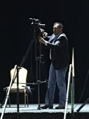 Pascal Enjady prepares the stage for the premiere of his first class of Youth Film Camp students.