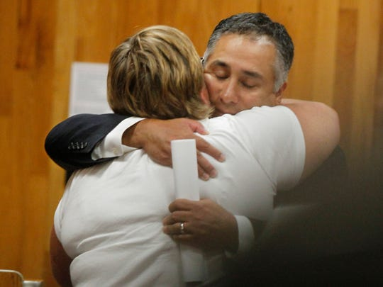 In this file photo, Armando Ramirez gets a hug of support from Laurel Avery-DeToy, assistant principal at School 33, at the Rochester City School District board meeting on July 24.