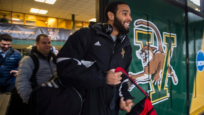 Leaving early to beat major winter storm bearing down on Vermont, University of Vermont guard Dre Wills can't hold back a smile Monday night, March 13, 2017, the men's basketball team heading out from Patrick Gymnasium in Burlington. Next stop: Milwaukee, Wisconsin to face Purdue in the first round of the NCAA Tournament.