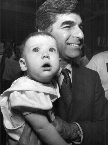 Michael Dukakis holds Danielle McCandless, daughter