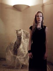 Dutch fashion designer Iris van Herpen with one of her innovative garments.
