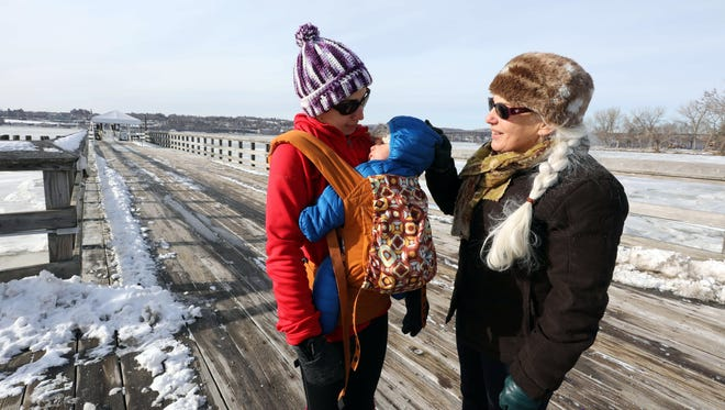 Alyssa Zulli, with her 7-month old daughter Lillian Bertholf and her mother Bonnie Zulli, tale a walk along the Beacon ferry dock in Beacon, Jan. 3, 2018.